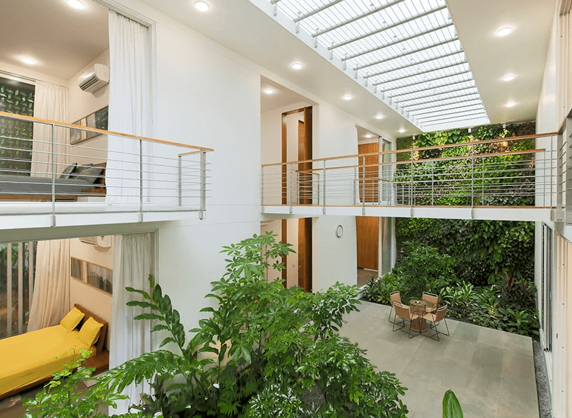 There are two bedrooms, one on each floor and a lush living wall