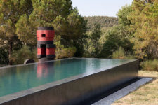 08 You may also see a large pool clad with concrete and surrounded with trees and greenery