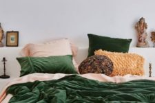 08 a bright and welcoming bed with a boho feel with green velvet and a woven fringe pillow