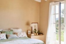 08 a chic bedroom with white as the main color, tan as a secondary and sage green for soft accenting