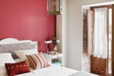 08 a red statement wall brings color to the space and spruces up the neutrals