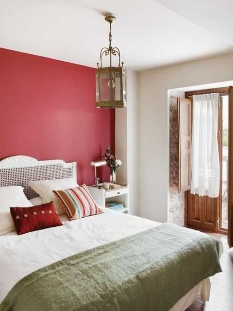 a red statement wall brings color to the space and spruces up the neutrals