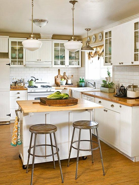 a rustic kitchen island with a wooden countertop, on casters and with holders can double as a meal space