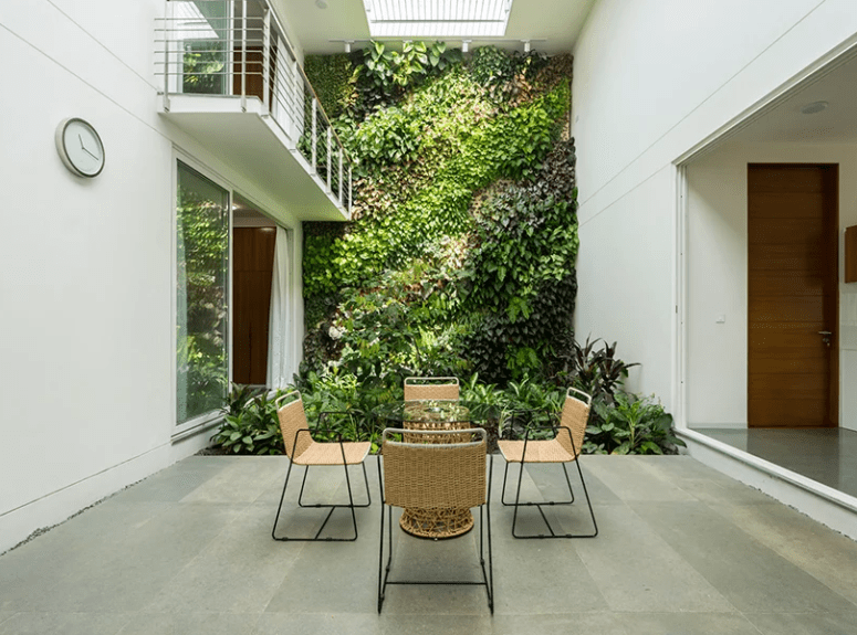 A sheltered patio with a living wall is an ideal place for having meals, it looks very welcoming