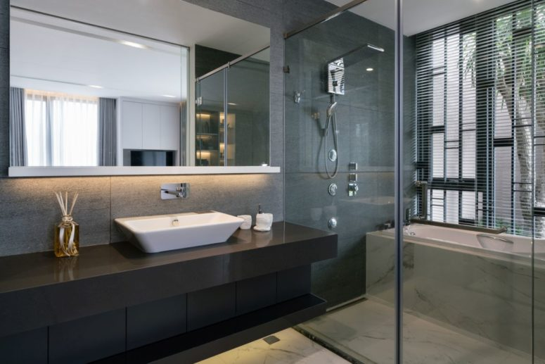 The bathrooms are open and airy, done in modern style with large mirrors