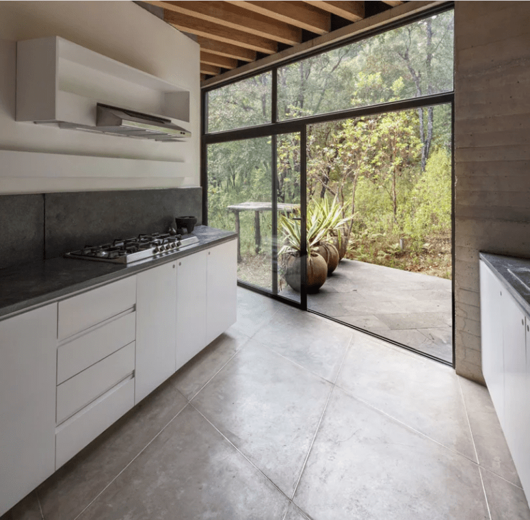 The kitchen can be also opened to outdoors with a sliding door