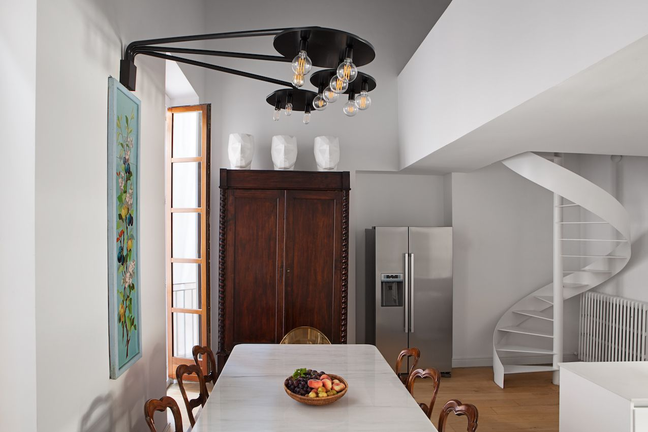 The kitchen eating space features a mix of modern and traditional, which is absolutely flawless