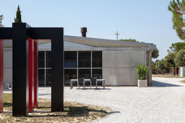 This is how the house looks outdoors, and a gravel backyard adds to its industrial nature