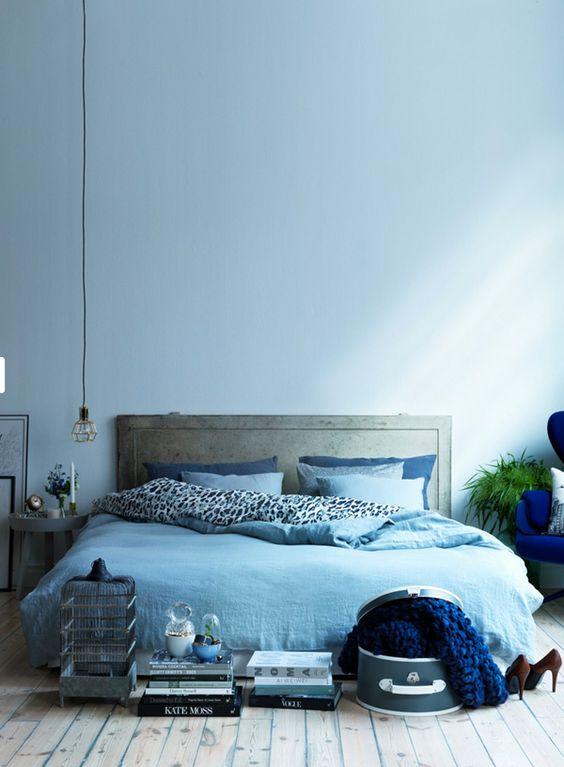 a light blue wall and matching bedding easily create a comforting ambience
