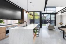 09 a statement point is sleek black upper cabinets of the kitchen, the color is echoed in other elements of the space, too