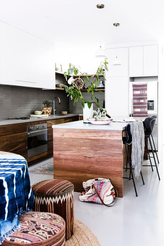 potted greenery, wood and colorful boho textiles and upholstery create a boho feel