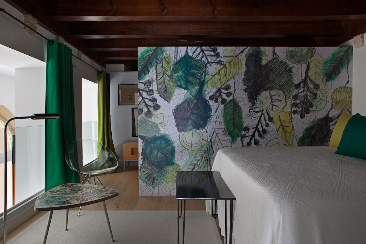 Bold murals can be seen throughout the house, they bring color, interest and divide spaces
