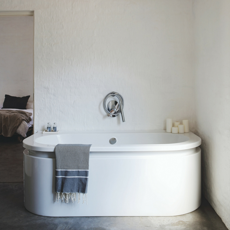 The bathroom is also very peaceful, with a comfy tub and some candles, there's no door between it and the bedroom