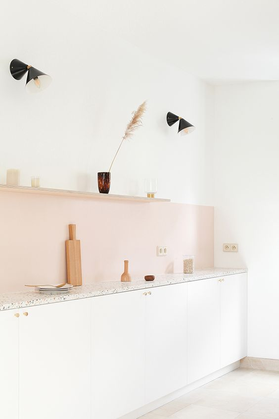 a blush kitchen backsplash adds a subtle touch of color to the neutral space