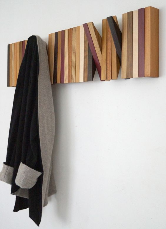 a colorful wall unit of wooden planks that can be used when you want or hidden when not in need