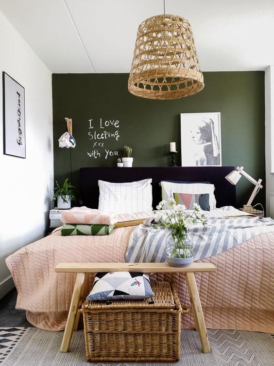 a dark green chalkboard wall makes the space more interesting and allows chalking on it