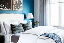 10 a monochromatic bedroom is infused with color – a bold blue accent wall that makes it vivacious