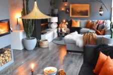 10 a space done in grey shades and enlivened with bold orange touches in each corner