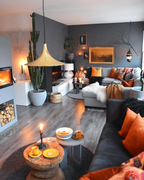a space done in grey shades and enlivened with bold orange touches in each corner