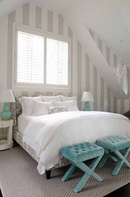 an attic bedroom in white, grey as a secondary color and touches of turquoise here and there
