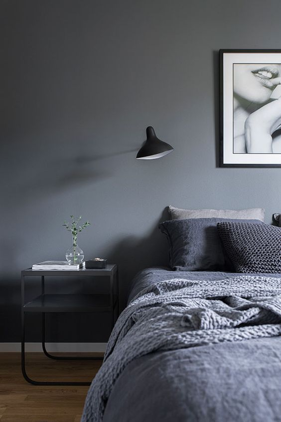combine greys and black for creating a trendy moody space, add textures with blankets