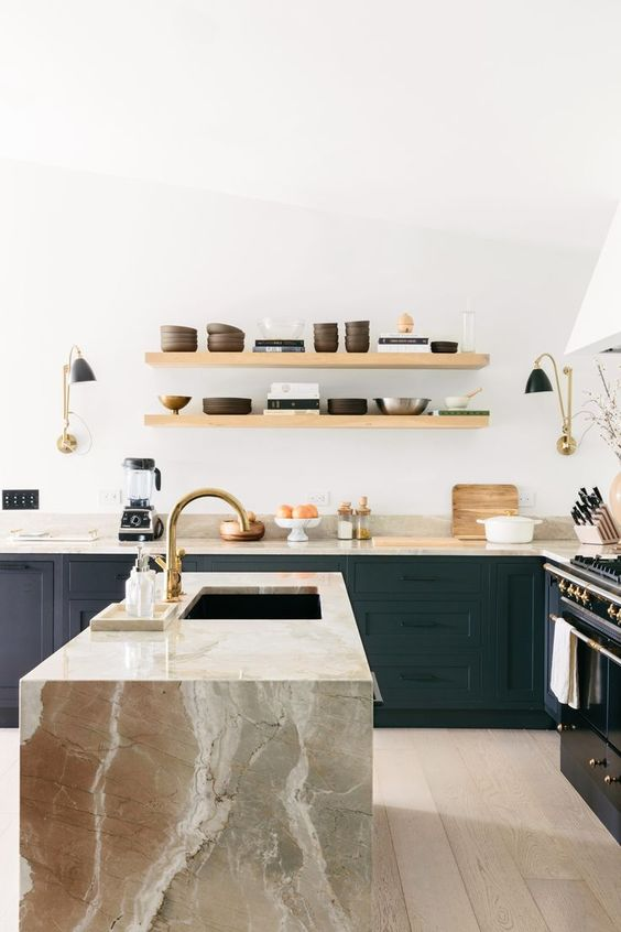 dark cabinets and a large stone kitchen island and countertops of the same stone for a wow effect