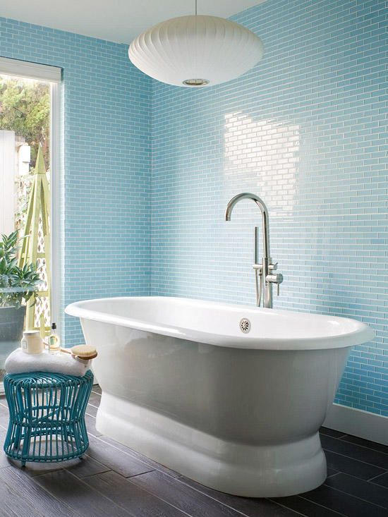 light blue tiles on the walls and a matching wire stool plus whites for a relaxing ambience
