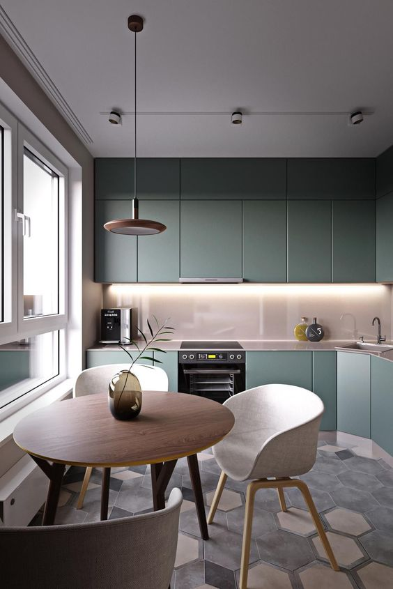 soft grey tones as dominant ones and an olive green kitchen for a soft and chic space