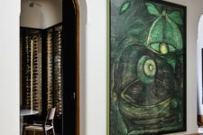 11 Stunning artworks from the owner's collection add to the space