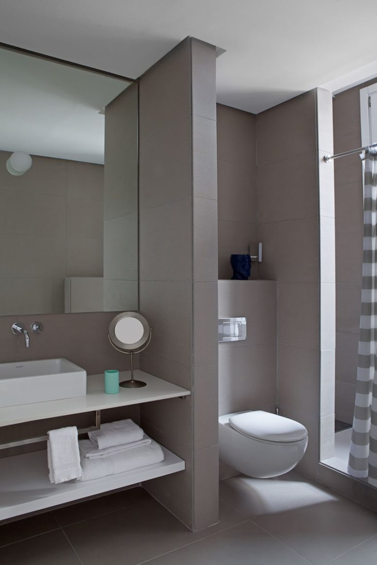 The bathroom is soothing and minimalist