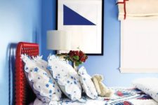 11 a bright red bed is a statement in a blue bedroom and an interesting color touch
