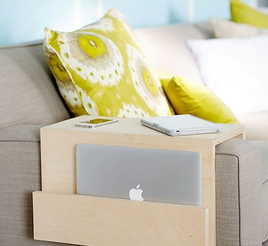 a minimalist plywood sofa caddy with a pocket for gadgets is a great piece for any living room