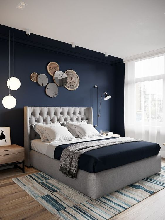 a navy accent wall is great for a contemporary bedroom, it highlights the sleeping zone