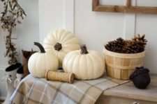 11 a simple display with a basket of pinecones, some white pumpkins and cotton in a pallet box