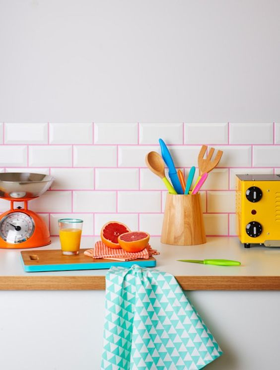 spruce up your usual white subway tiles with hot pink grout to make it look more playful