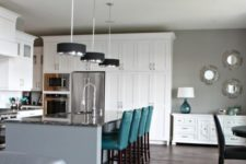11 touches of teal in each space of this stylish open layout enliven it and make it bolder