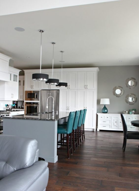 touches of teal in each space of this stylish open layout enliven it and make it bolder