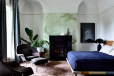 12 The master bedroom shows off a gorgeous green onyx wall, a built-in fireplace and a bold bed