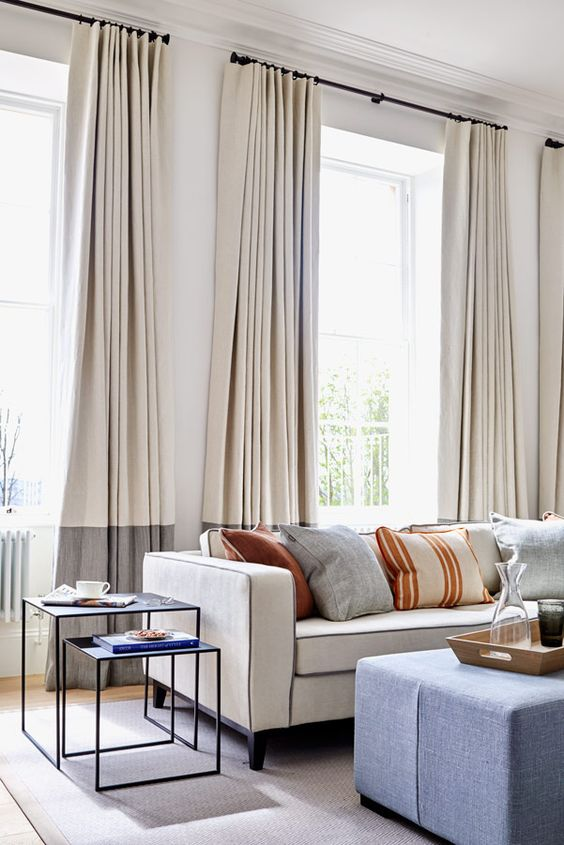 a bold and modern idea is color block curtains in two contrasting shades that are sure to add chic