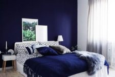 12 a bold blue accent wall plus a matching pillow and a fringed blanket for a wow effect