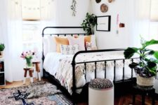 12 a bold boho rug and a matching ottoman, some boho bedding and a fringe chandelier make up a boho look