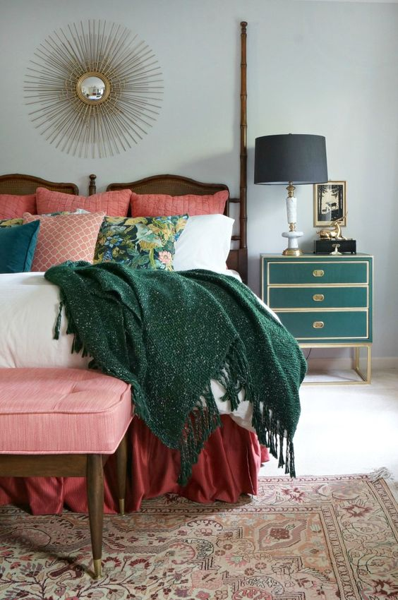 a chic art deco green and gold nightstand and a matching comfy blanket