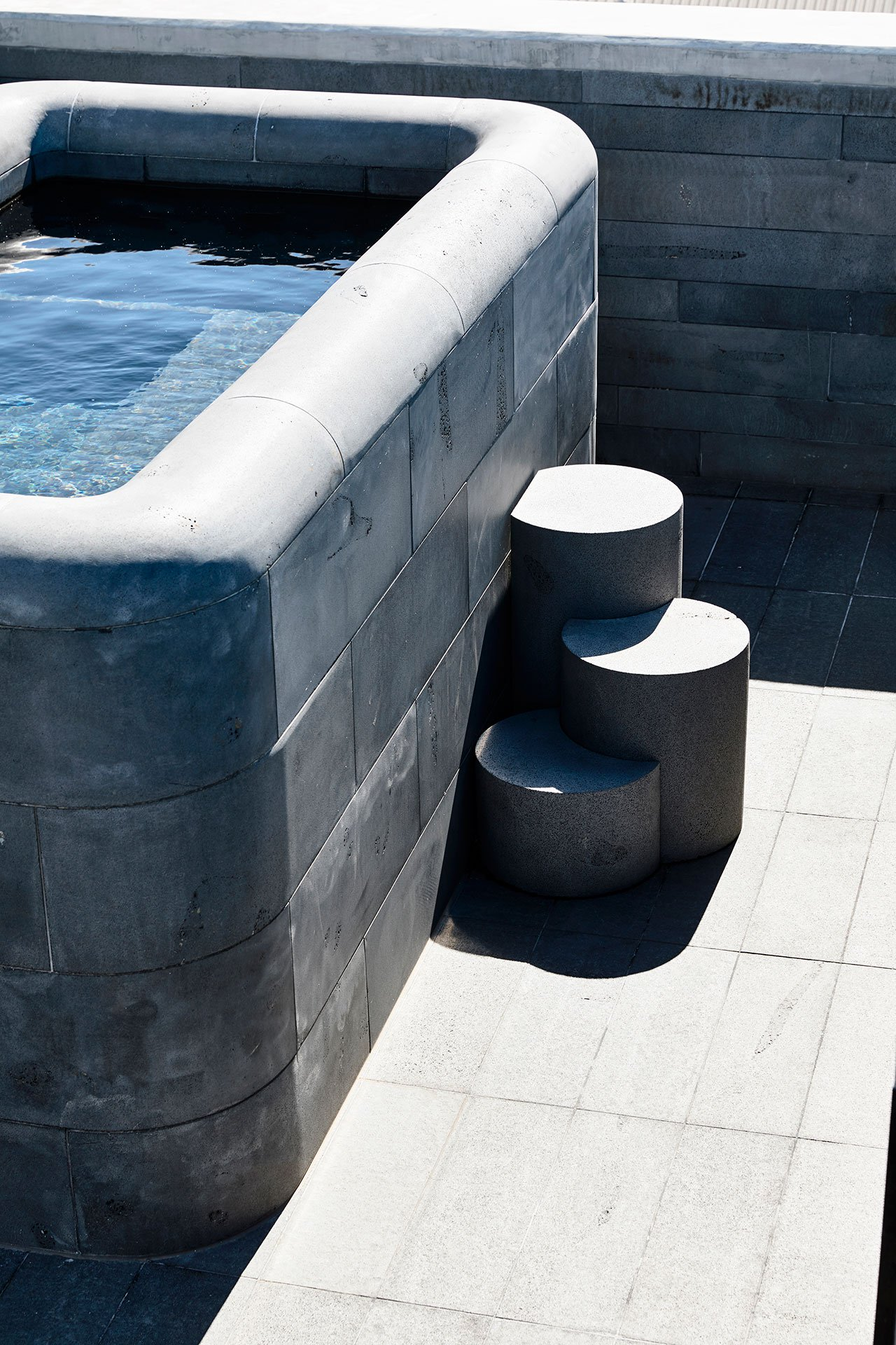 There's also an outdoor stone clad bathtub