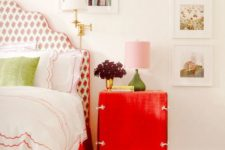 13 a bright red nightstand and a red floral print upholstered bed for a cute touch