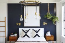 13 a navy statement wall and gilded touches create a very chic and bold space with a boho feel