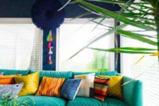 13 an assortment of bright and colorful pillows makes the living room lively and bold