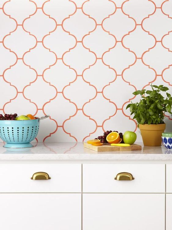 white arabesque tiles for the kitchen backsplash and bold orange grout to highlight it