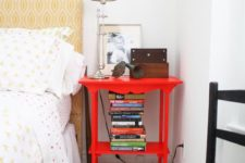14 a bright red nightstand matches the bedroom style but adds a touch of super bold color