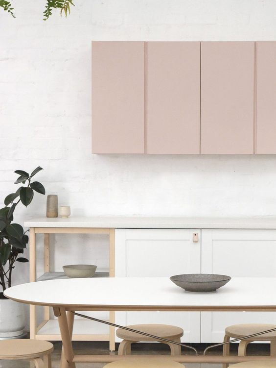 a chic contemporary kitchen with white and blush cabinets shows off the two-tone trend
