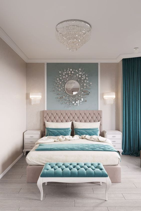 a glam and relaxing bedroom with grey and teal as two main opposing colors